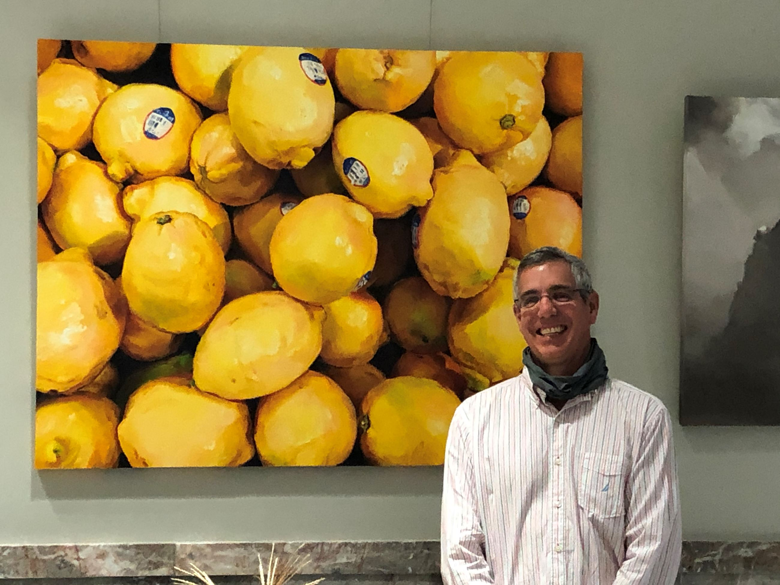 "Best of show winner Ray Kleinlein in front of his painting, ""Lemons"""
